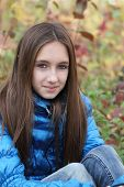 image of teenage girl  - Young teenager girl in the autumn forest - JPG
