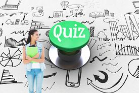 picture of quiz  - The word quiz and student holding notepads against digitally generated green push button - JPG