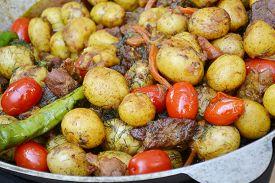 foto of cauldron  - Big cauldron with roasted potato - JPG