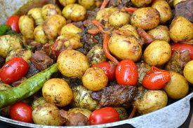 image of cauldron  - Big cauldron with roasted potato - JPG