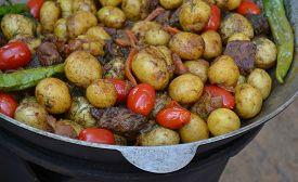 picture of cauldron  - Big cauldron with roasted potato - JPG
