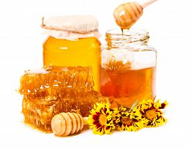 picture of honeycomb  - Honeycomb and jars of honey with stick and flowers isolated on white background - JPG