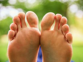 stock photo of painted toes  - a pair of feet on all ten toes  - JPG