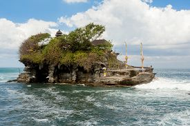 stock photo of tanah  - famous Tanah Lot Temple on Sea in Bali Island Indonesia with blue sky and waves  - JPG