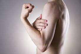 picture of cubit  - Man with pain in arm - JPG
