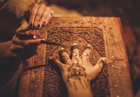 picture of vedic  - Drawing process of henna menhdi ornament on woman - JPG