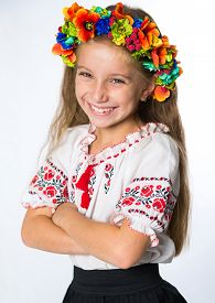 stock photo of national costume  - portrait of a happy little Ukrainian  girl in the national costume - JPG
