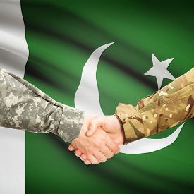 foto of pakistani flag  - Soldiers shaking hands with flag on background  - JPG