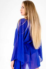 foto of tunic  - A girl in a light blue cape tunic clear and high - JPG