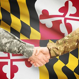 stock photo of maryland  - Soldiers handshake and US state flag  - JPG