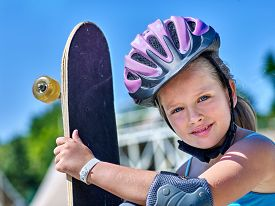 pic of skateboard  - Portrait of kid with his skateboard  outdoor - JPG