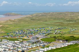 foto of caravan  - View from Rhossili Down to Burry Holms and Hillend The Gower peninsula Wales UK in summer with caravans and camping on the campsite - JPG