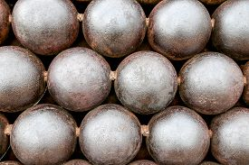 stock photo of cannon-ball  - Cannon Balls arranged in a pile like atoms - JPG