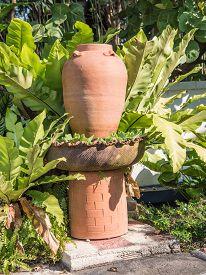 image of pottery  - garden decoration by pottery jar pottery pitcher - JPG