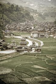 foto of dong  - Aged image of Dong Chinese Village on the rice terrace at sunset - JPG