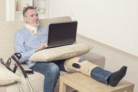 foto of neck brace  - Man with leg in neck brace - JPG