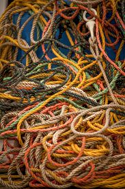 stock photo of nylons  - A pile of braided multifilament polypropylene covered lobster and crab fishery polyester nylon trap cord - JPG