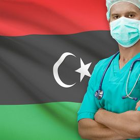 picture of libya  - Surgeon with flag on background  - JPG