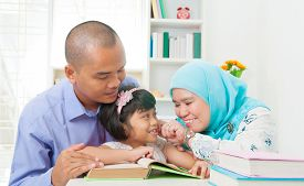 picture of malay  - Malay family reading in the living room - JPG