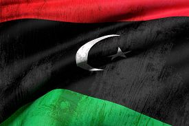 pic of libya  - 3d rendering of an od and dirty Libya flag waving - JPG