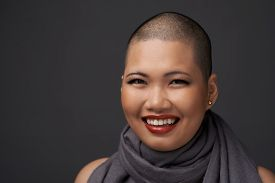 picture of shaved head  - Face of laughing Vietnamese woman with shaved hairstyle - JPG