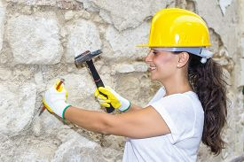 stock photo of chisel  - Woman with hammer and chisel in the work - JPG