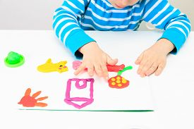 picture of daycare  - little boy playing with clay dough - JPG