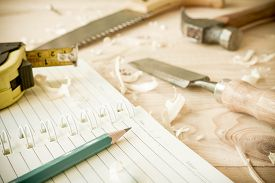 picture of chisel  - joiner tools chisel and meter on wood table background - JPG
