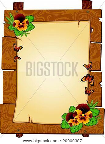 Een vel papier met een plaats voor de tekst op de houten achtergrond met vlinders en bloemen