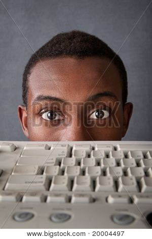 Eyes Of Man Above Keyboard