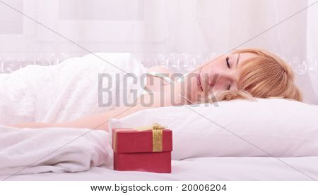 Cute Woman Lying On Bed