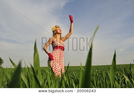Woman Standing In A Field