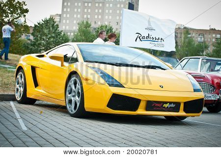 Yellow Lamborghini on exhibition parking
