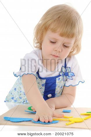 The Serious Little Girl Plays.