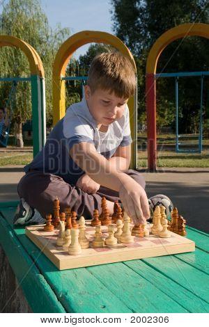 Boy Play A Chess
