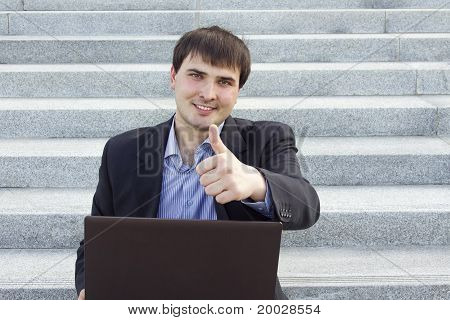 Modern business man thumbs up