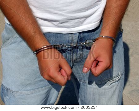 Hands Of The Man - The Criminal, Chained In Handcuffs