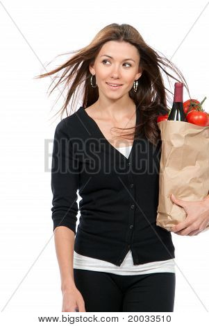 Happy Woman Holding A Supermarket Paper Shopping Bag Full Of Groceries