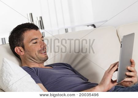 tablet on sofa