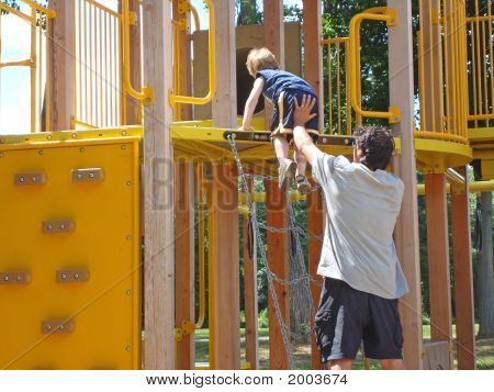 Father And Son – A Leg Up At The Playground