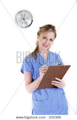 Lady Nurse Writing In A Chart