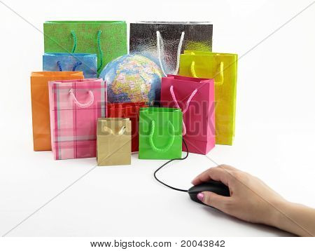 Computer Mouse Connected To A Group Of Shopping Bags With A Globe Inside
