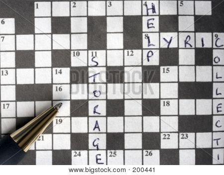 Semi Solved Crossword Puzzle With Pen