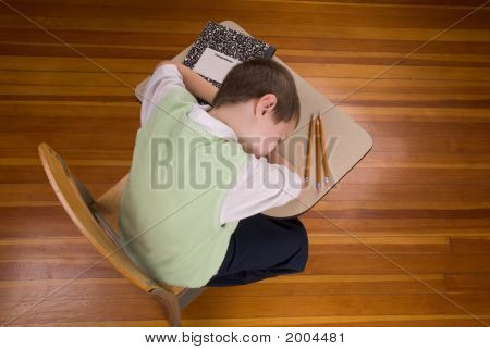 Boy Sleeping At School Desk