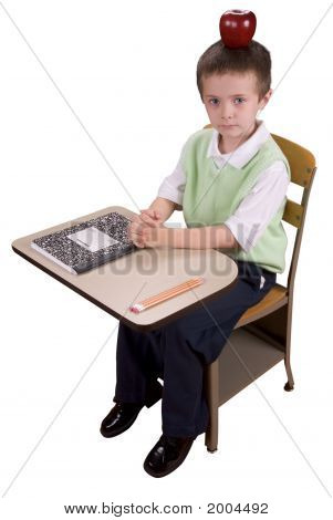 Boy At School Desk