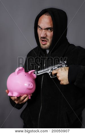 gun and pink piggy bank