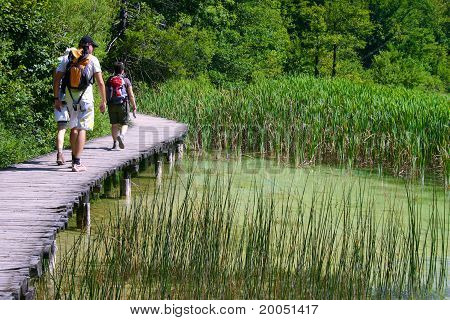 People Walking In A Bridge Of Wood In Plitvice Lakes.