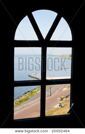 View At The Sea Through A Window Of The Dutch Lighthouse Of Urk
