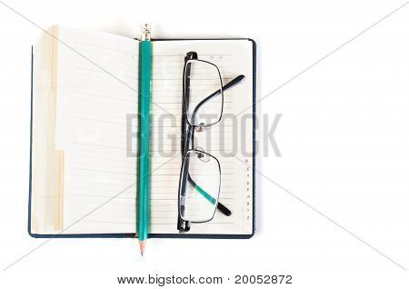 Notebook And Eyeglasses