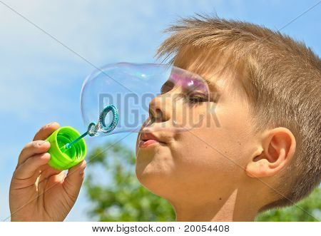 A Little Boy Blows Bubbles